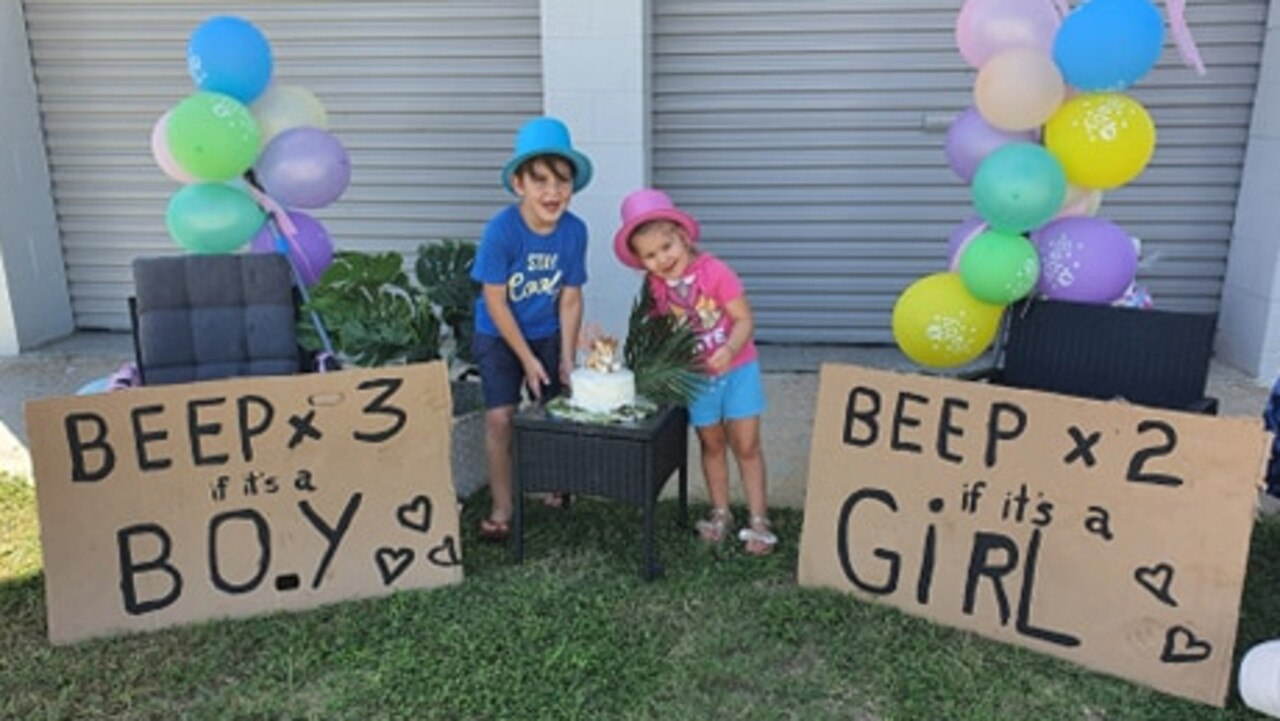 Jamii Barlett said her two young kids loved the drive-by baby shower, holding up signs for passers-by to guess the sex. Picture: Supplied.