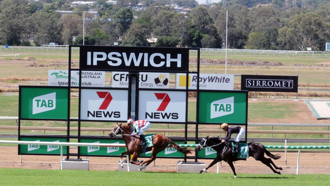 Kirra Lass strides to victory in the first race back since October at the Ipswich track today. Picture: Claire Power