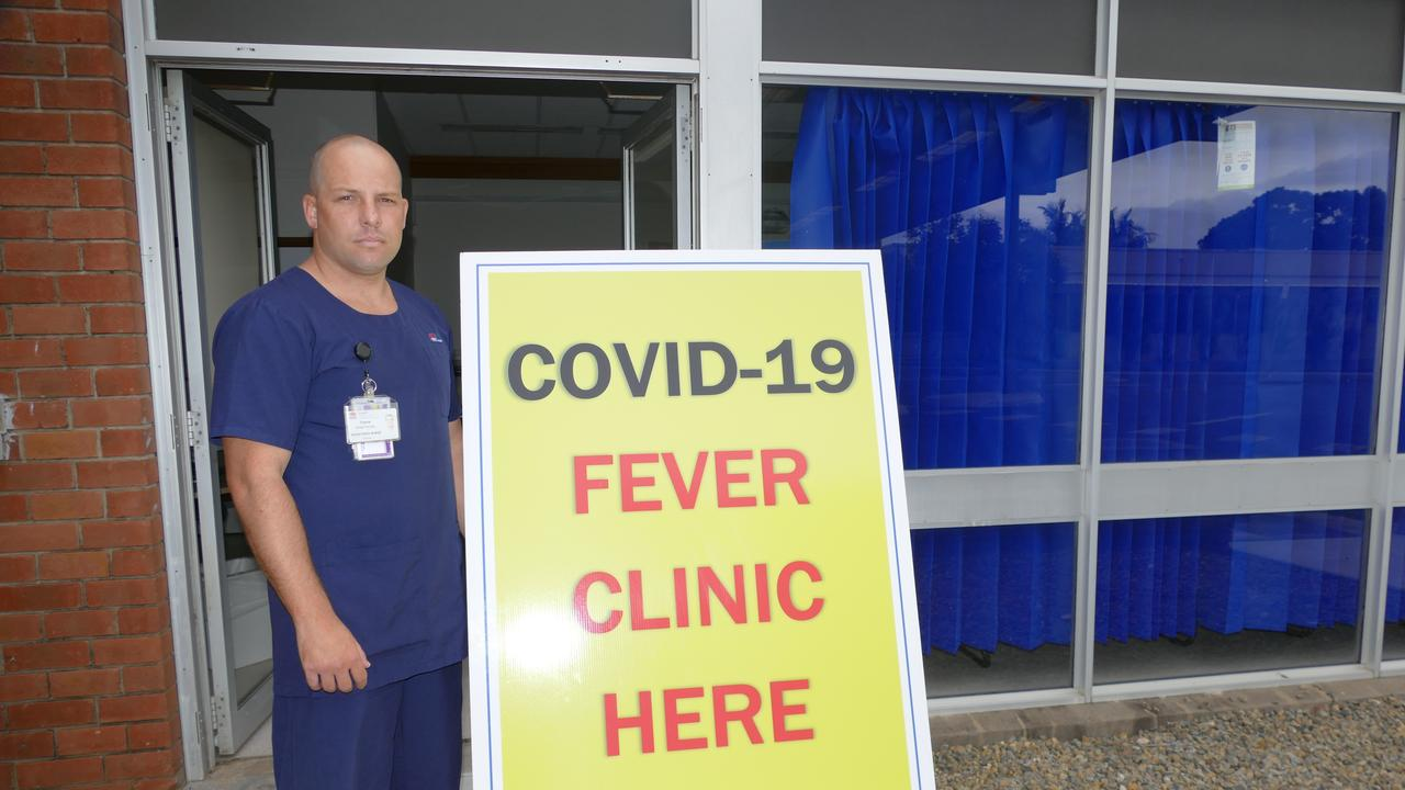 A manager of the COVID-19 Fever Clinic at Grafton Base Hospital, Travis Armstrong putting out some of the signage for clinic which opened on Monday morning.