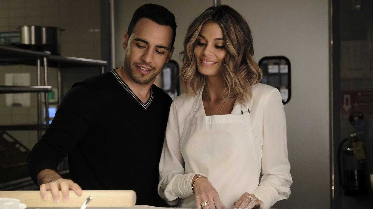 Victor Rasuk and Nathalie Kelley in a scene from the TV series Baker and the Beauty.