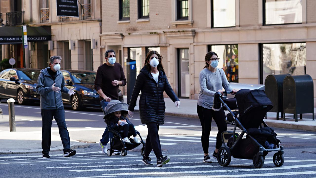 People wearing protective masks and gloves during the coronavirus pandemic on April 12, 2020 in New York City. Picture: Cindy Ord/Getty Images.