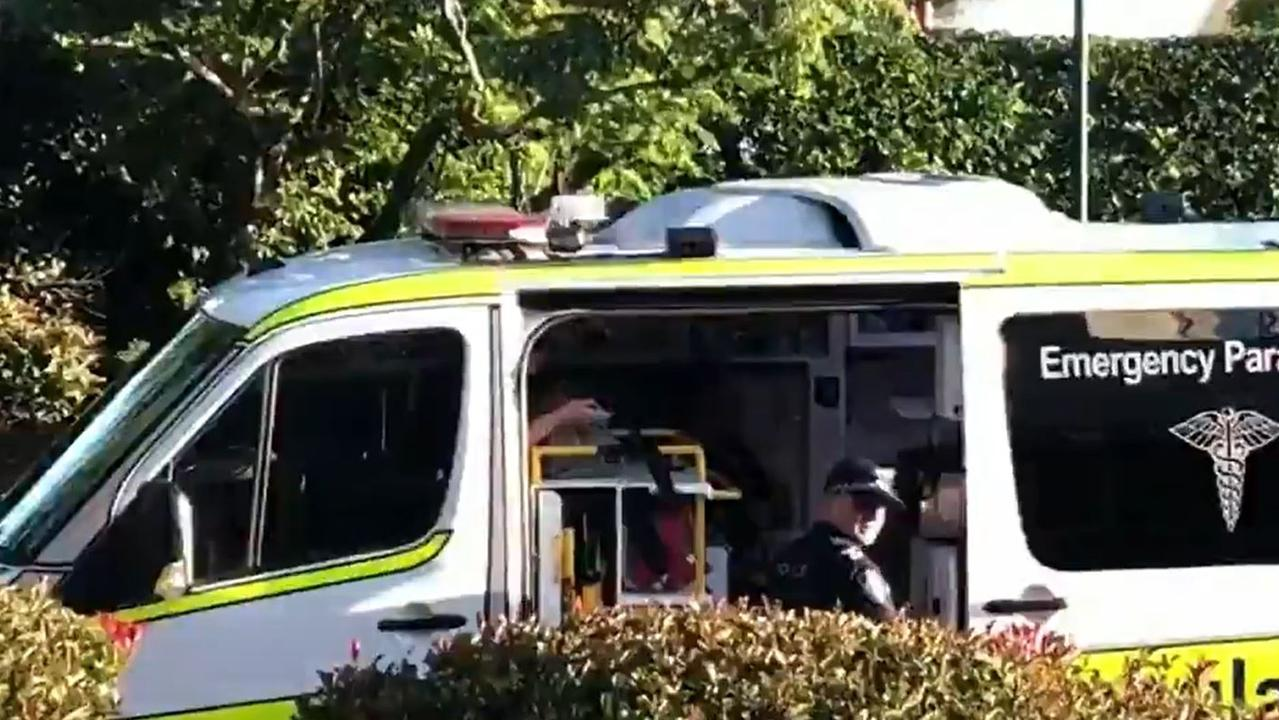 Paramedics on scene after the arrest at Benowa Gardens Shopping Centre. Picture: Nine News Gold Coast
