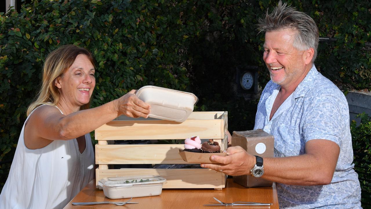 Gary and Pam Forrest unpack a date night hamper pack. Photo: John McCutcheon