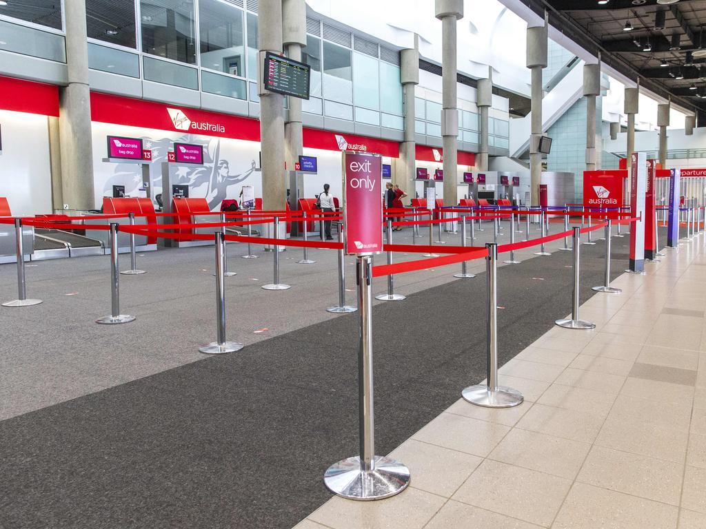 Empty Virgin Australia check-in terminal at Brisbane Domestic Airport.