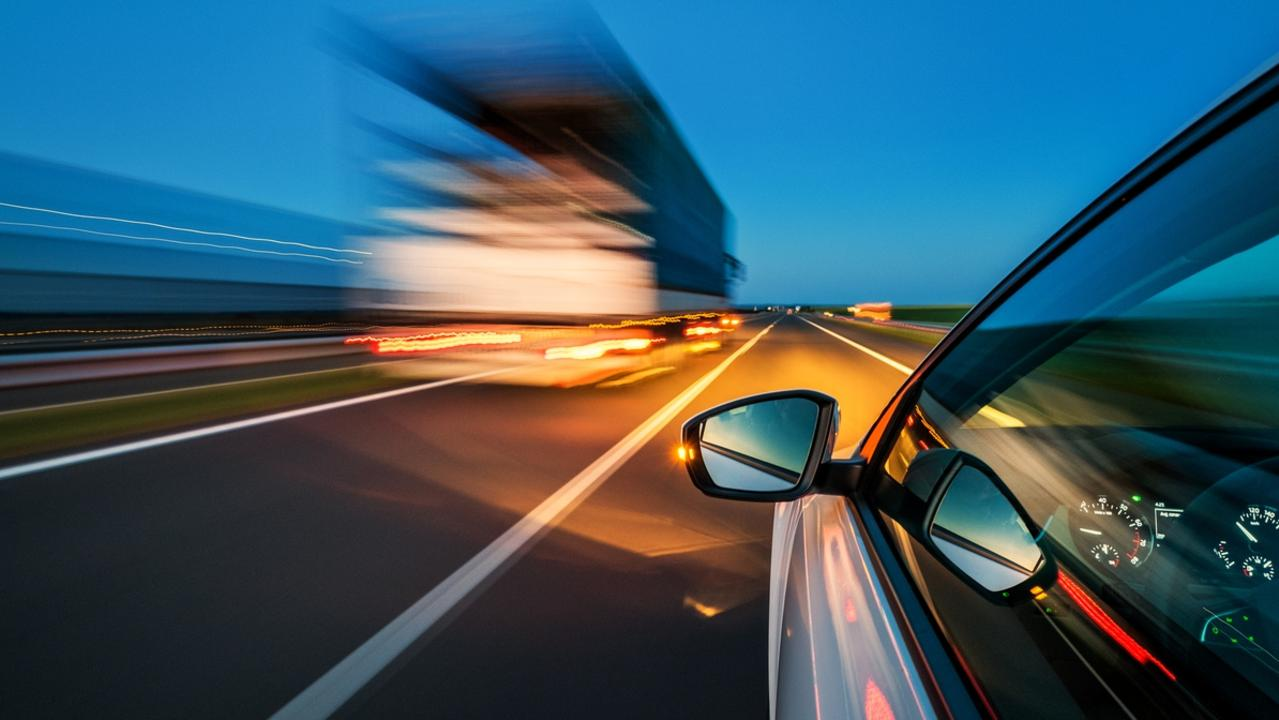 A generic photo of a car speeding on the highway.