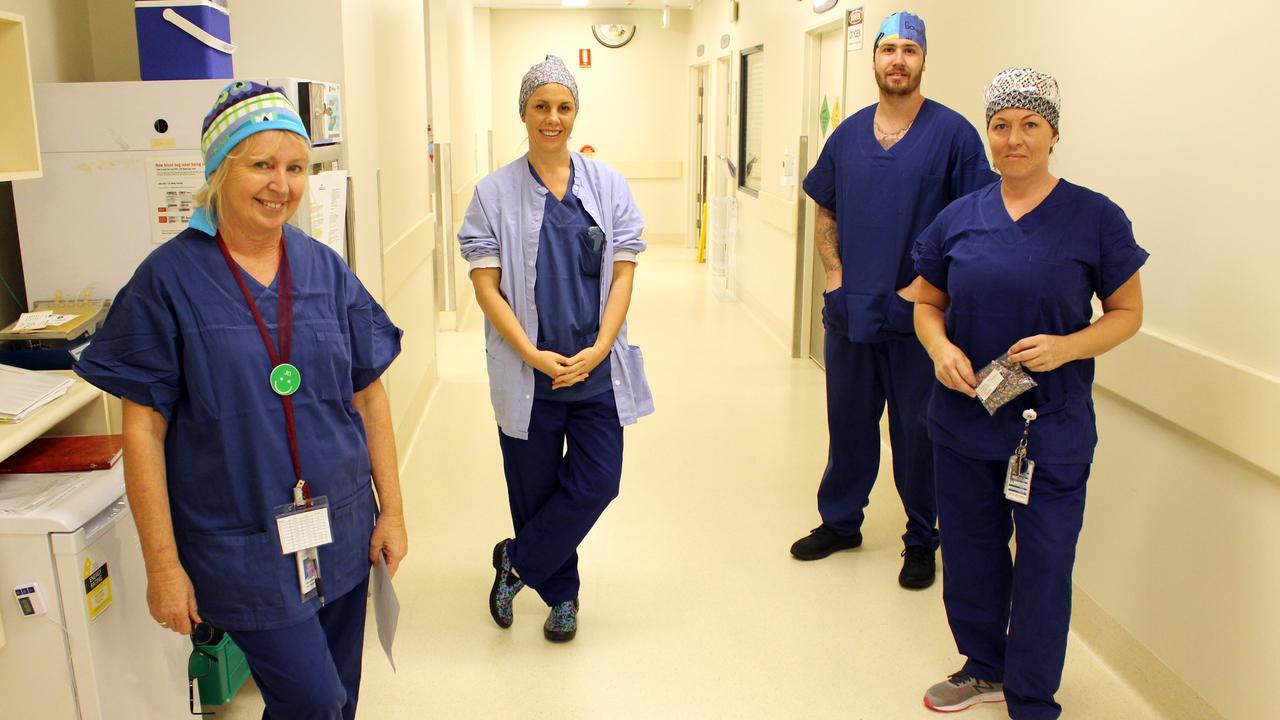 KINDNESS: Buderim Private Hospital Theatre team Jo Andrews, Rachelle Presland, Josh Lee and Tamara McNee in donated scrub caps.