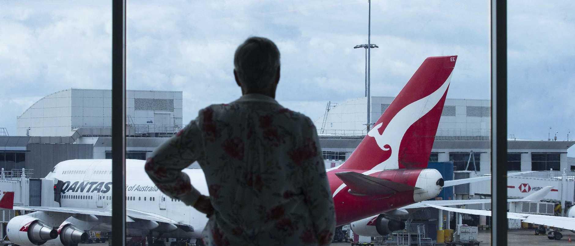 Qantas cuts flights