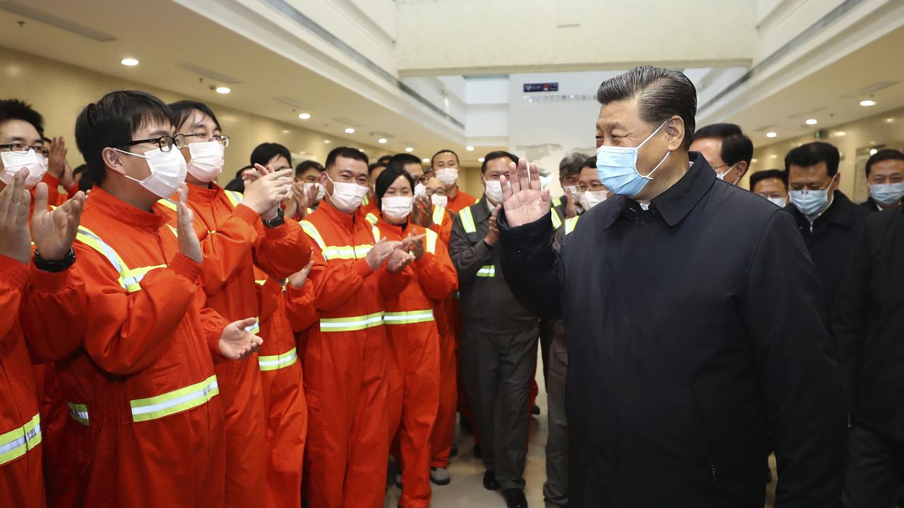 Chinese President Xi Jinping visits workers in east China's Zhejiang Province. Picture: AP.