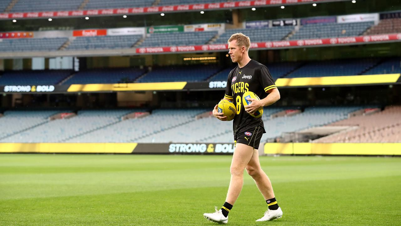 Jack Riewoldt walks on the MCG in front of no fans before Round 1. Picture: Getty