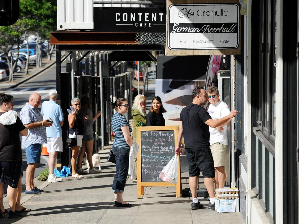 Many Australians are still ducking out to get their daily caffeine fix from cafes. Picture: Simon Bullard/AAP