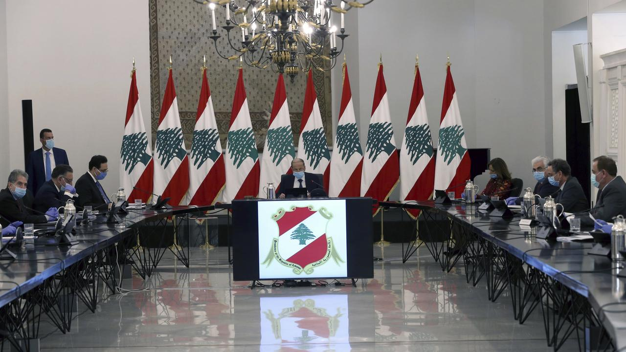 The Lebanese Government, with President Michel Aoun in centre, wearing masks and gloves to help protect themselves from the coronavirus, while attending a cabinet meeting in Beirut late last month. Picture: AP