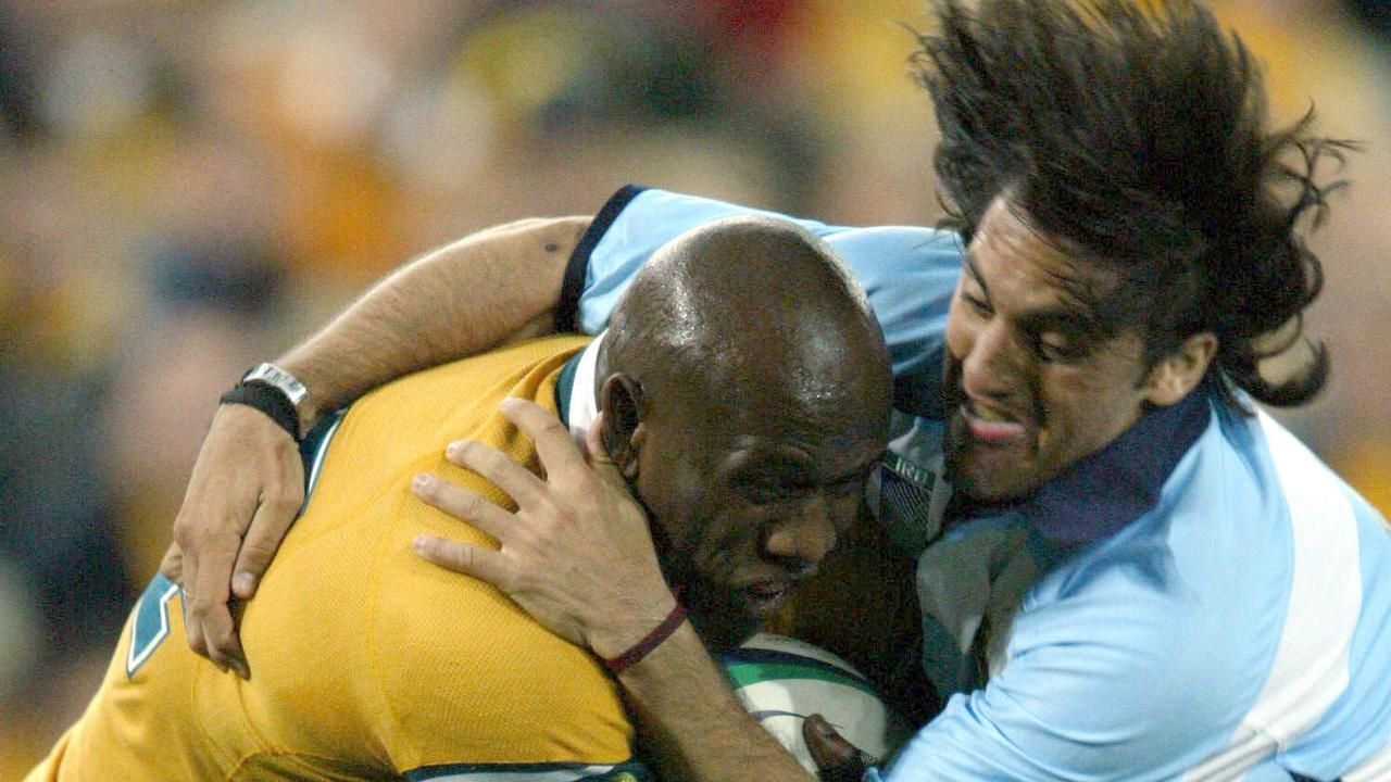 Australia's Wendell Sailor fights through the tackle of Agustin Pichot in 2003 Picture: Colleen/Petch sport union action