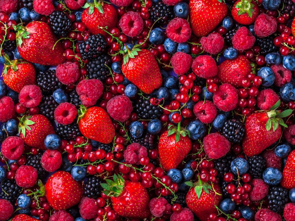 Make sure berries are arranged in a single layer on a baking tray before transferring them to an airtight container to freeze. Picture: Supplied