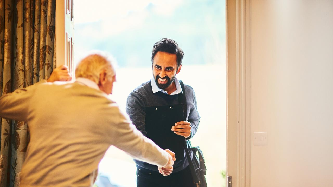 Senior man welcoming a healthcare worker - Home visit