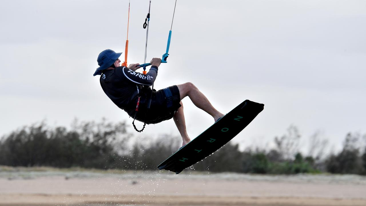 Perry Van Lint gets some airtime while kite surfing at Town Beach in Mackay. Picture: Tony Martin