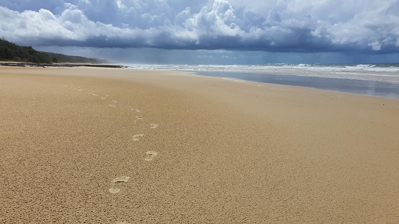 Nothing but footprints on the usually busy Fraser Island beaches, which Kevin and Adele Hockey are making the most of.