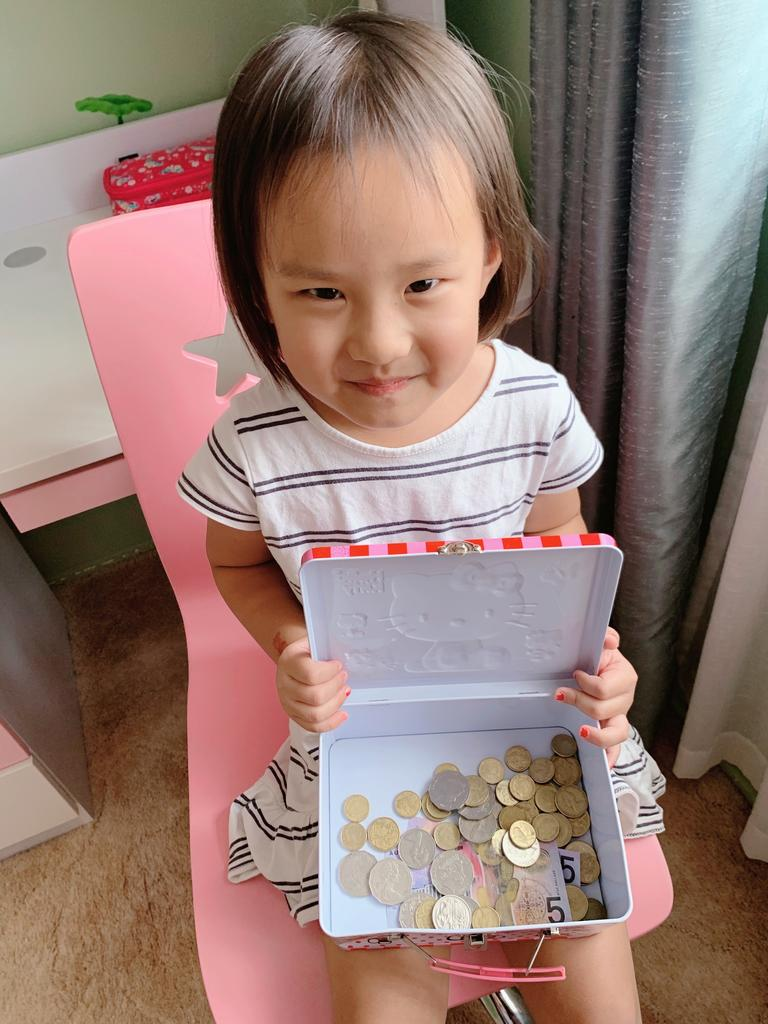 Agnes Han with her piggy bank donation.
