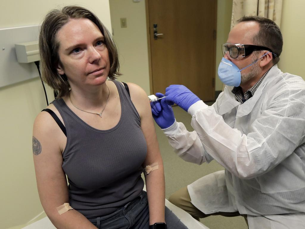 Jennifer Haller gets the first shot in the clinical trial of a potential vaccine for COVID-19. Picture: Ted S. Warren/AP