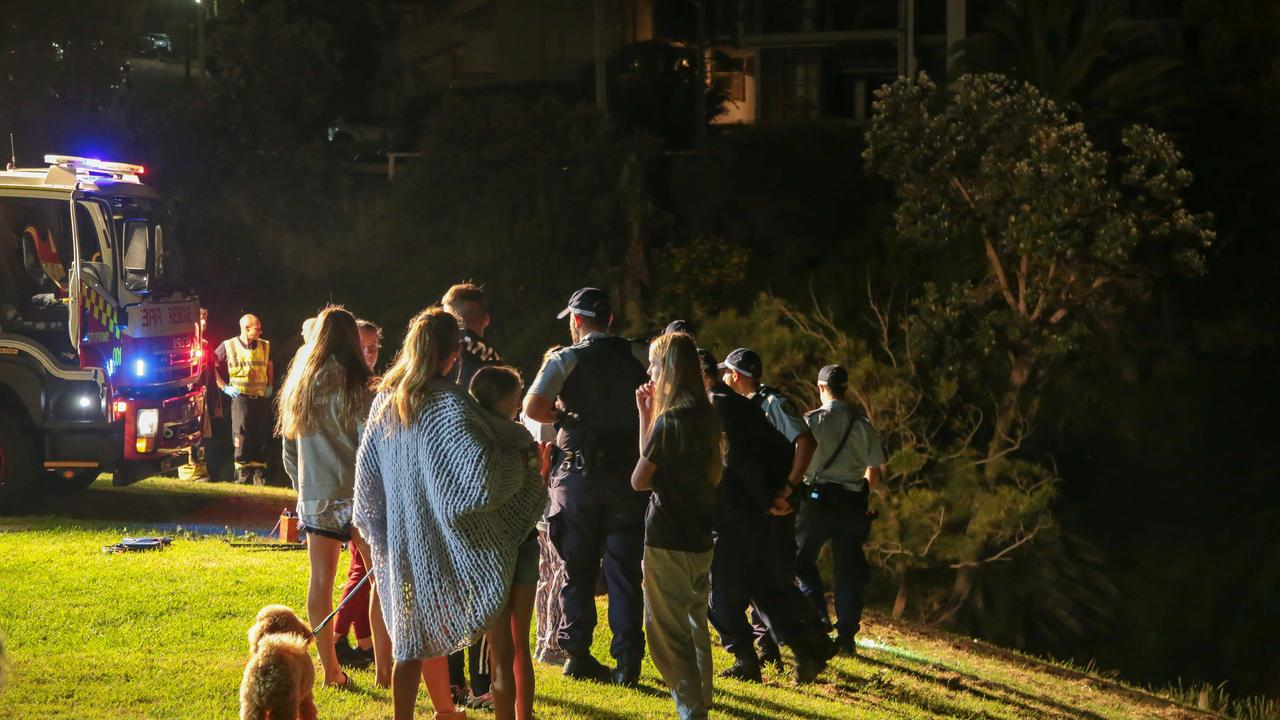 A number of residents and family look on while the rescue operation unfolded. Picture: Damian Hoffman