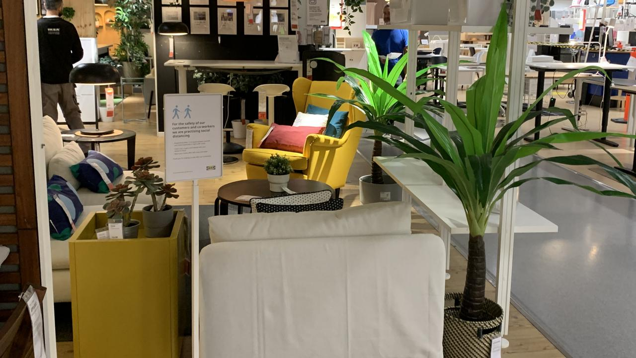 This seemingly random collection of furniture is actually a makeshift barricade to keep customers and staff apart. Picture: Benedict Brook/news.com.au