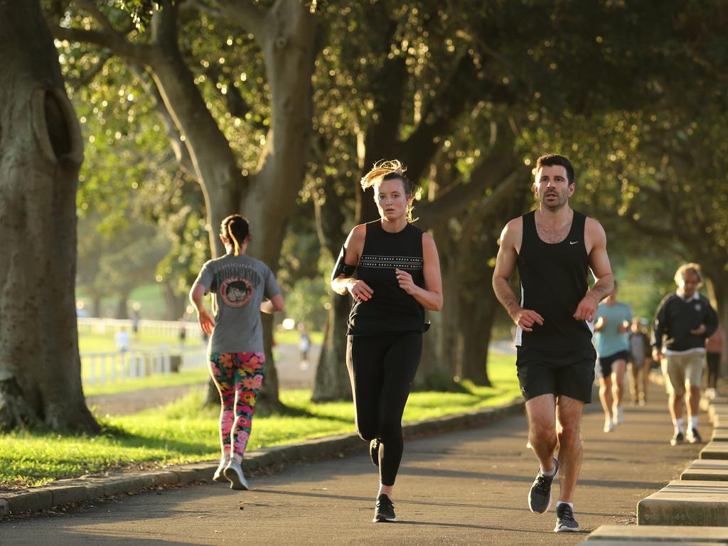 People exercising in Sydney's Centennial Park. Many people are using the lockdown period to actually improve their health – and for a lot of people, that means cutting back on alcohol.. Picture: Britta Campion