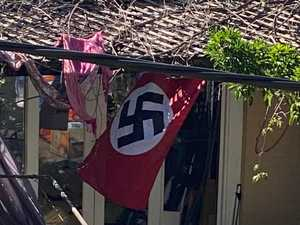 Backyard Nazi flag 350m from synagogue