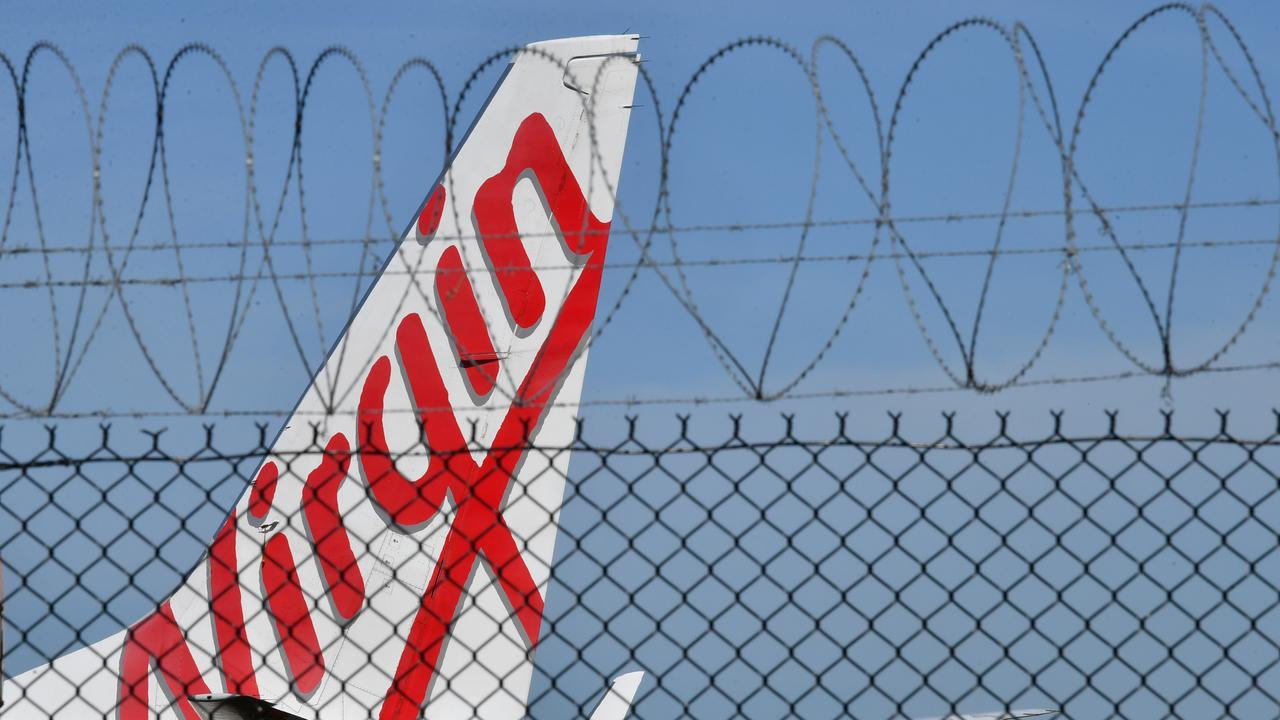 State Development minister Cameron Dick announced a $200 million national support package to help get Virgin get back in the skies, and he called on other states and the Federal Government to chip in. Photo: Darren England
