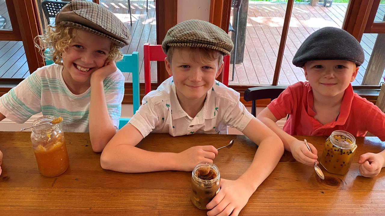 PINT-SIZED PRESERVERS: Charlotte, Eddie, and Johnny MacManus enjoying their homemade preserves.