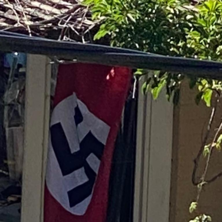A Nazi swastika flag flies in the backyard of a Newtown home.