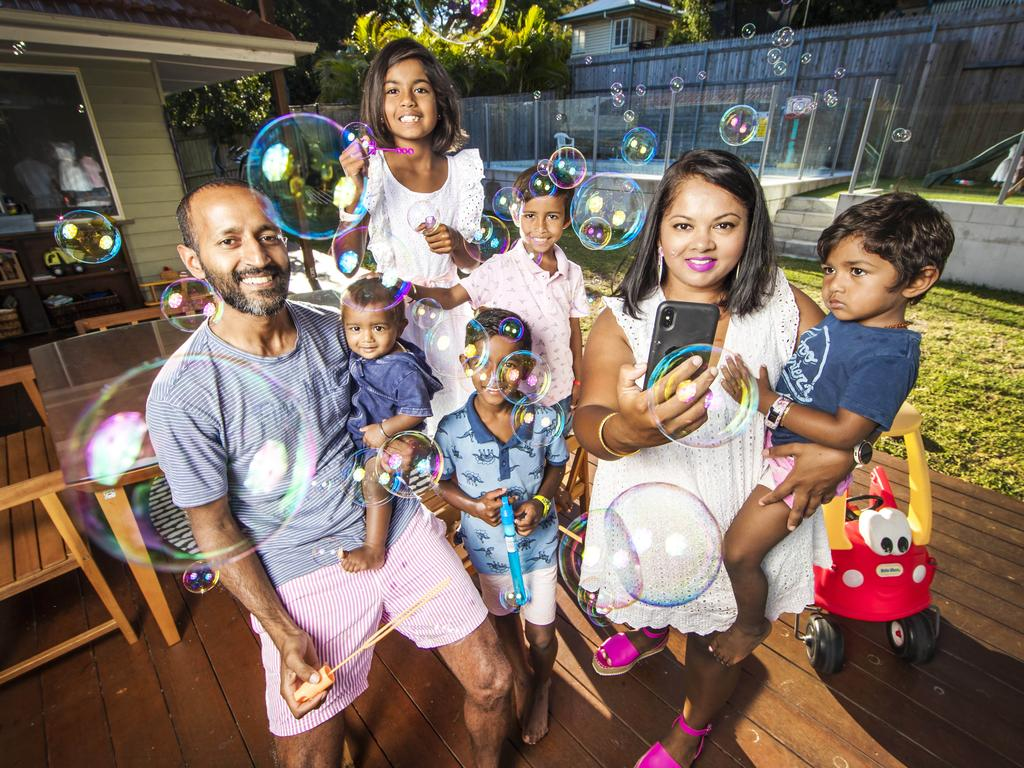Angeleen and Ravi Naidu from Brisbane are using the app to keep their five children entertained. Picture: Nigel Hallett