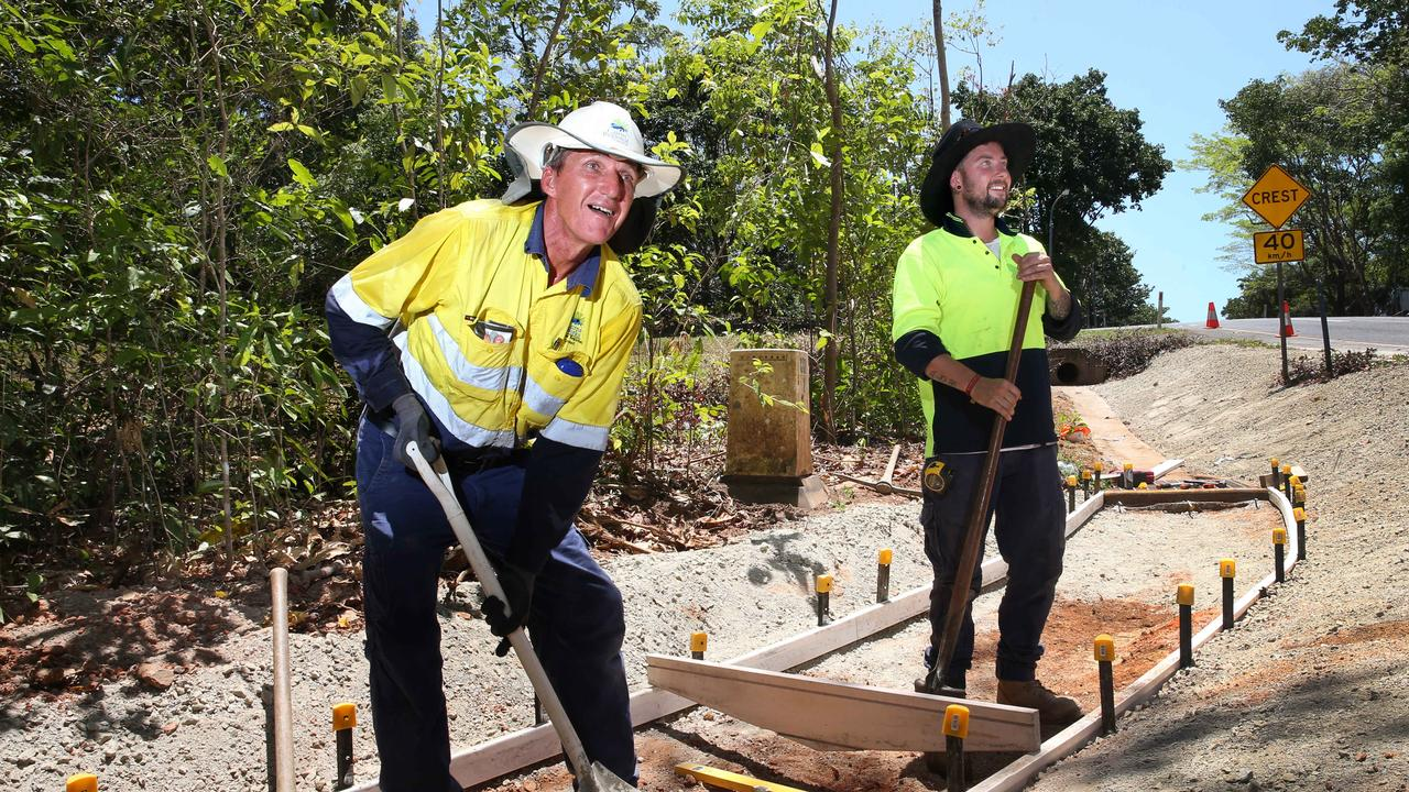 Cairns Council maintenance workers Ivan Orsag and Jack Booker at work in Redlynch. PICTURE: ANNA ROGERS