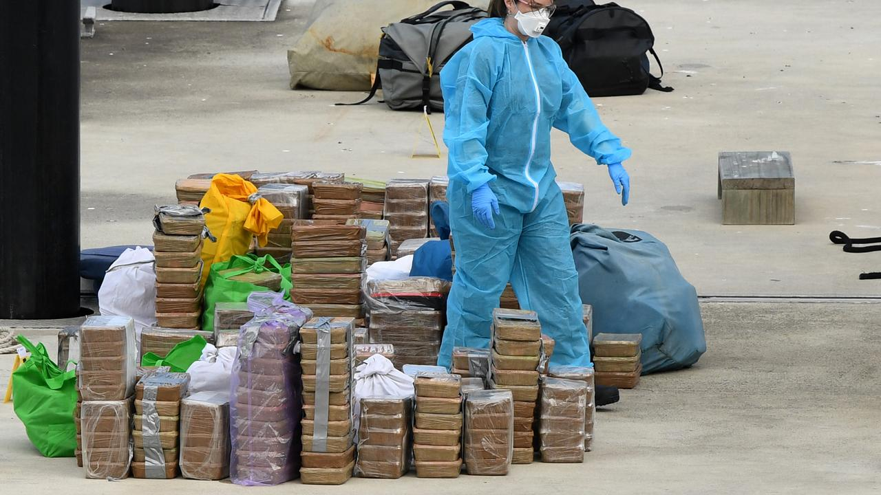 Police remove a large amount of methamphetamine from a yacht docked at Balmain on Sunday. Picture: AAP
