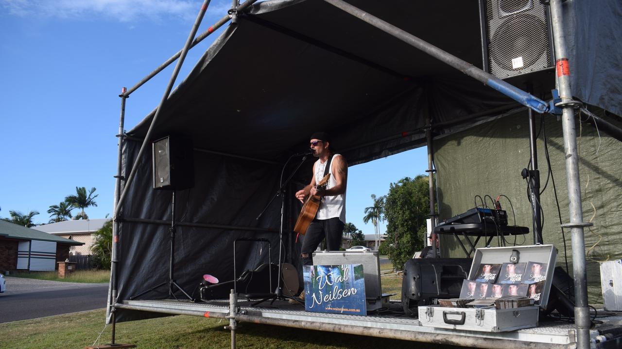 Musician Wal Neilsen playing to the neighbourhood.