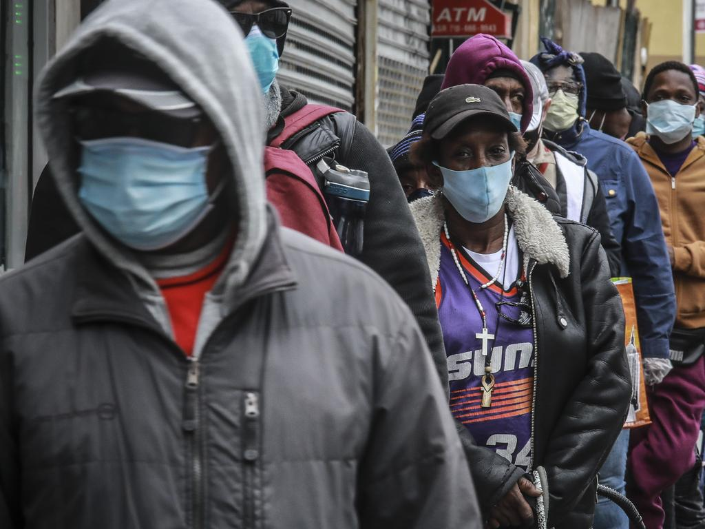 People wait for a distribution of masks in NY. Picture: AP