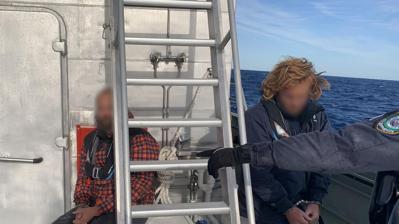 The two accused men on board the 50 foot yacht, which was intercepted early on Saturday 50 nautical miles east of Lake Macquarie. Picture: Supplied