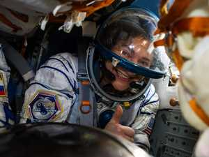 Astronauts return to virus-stricken Earth