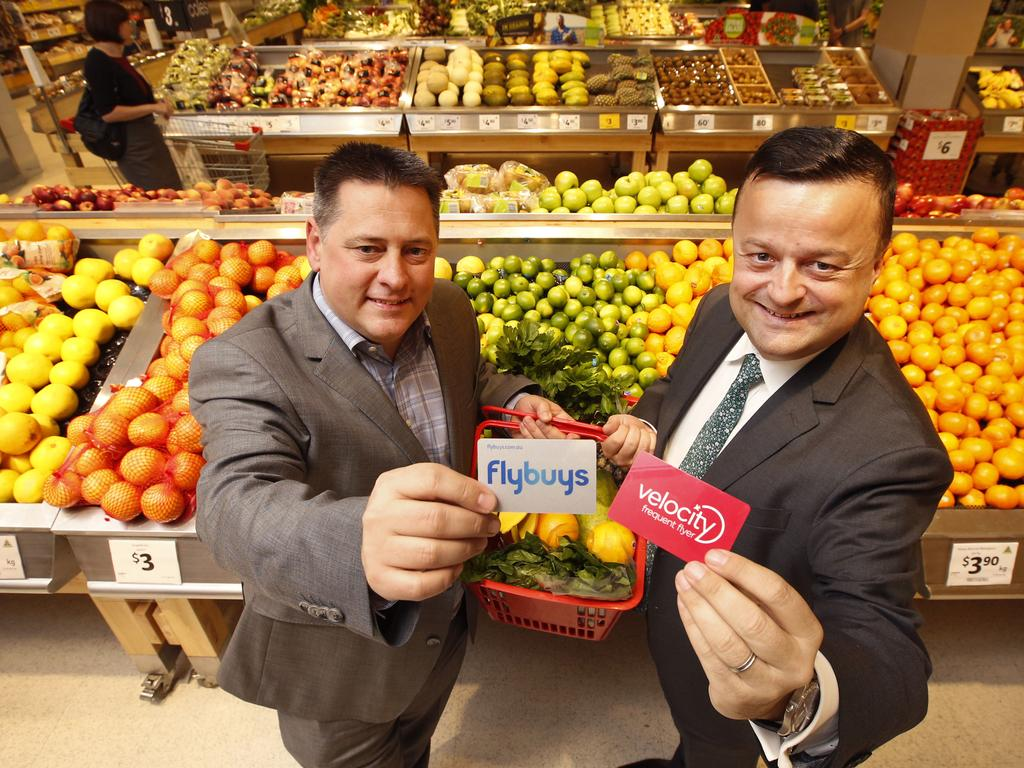 General Manager Flybuys Adam Story and CEO Velocity Frequent Flyer Karl Schuster linking up at Coles Glen Iris. Picture: David Caird