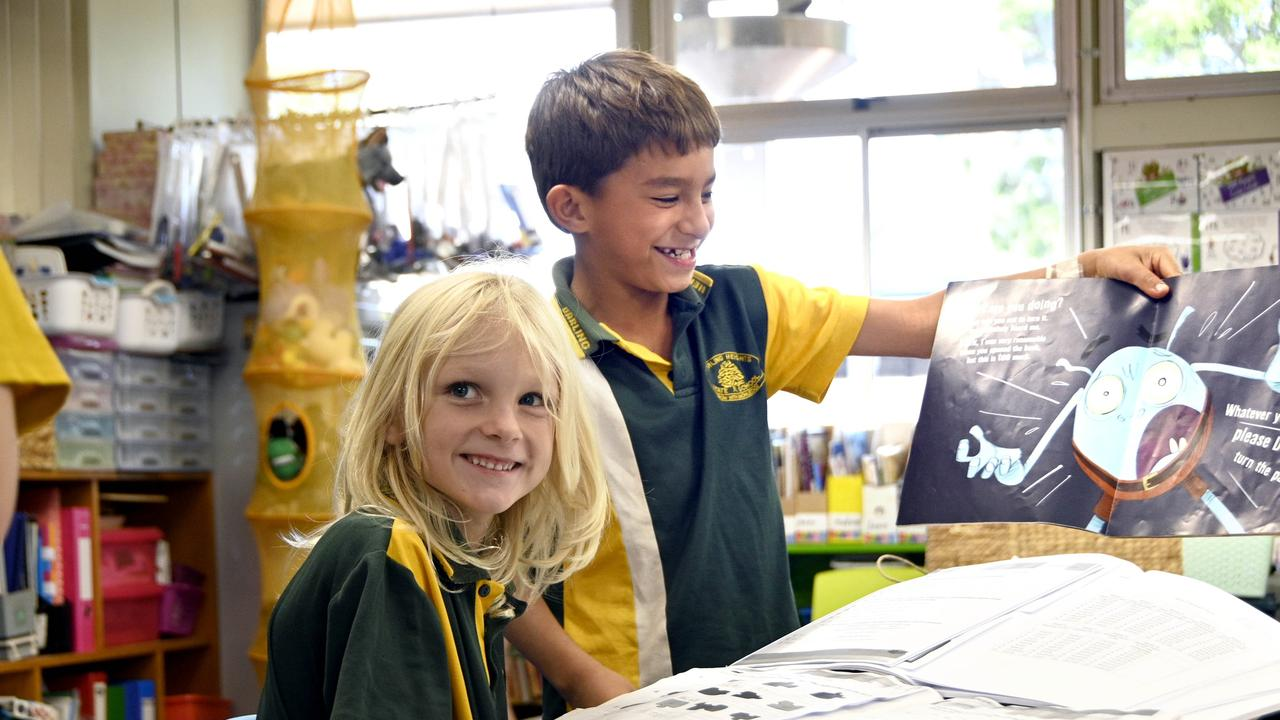 It was work as usual ysterday for Darling Heights State School students Harry Salmi (left) and Quinlan Wilson-Fuhlbohm.