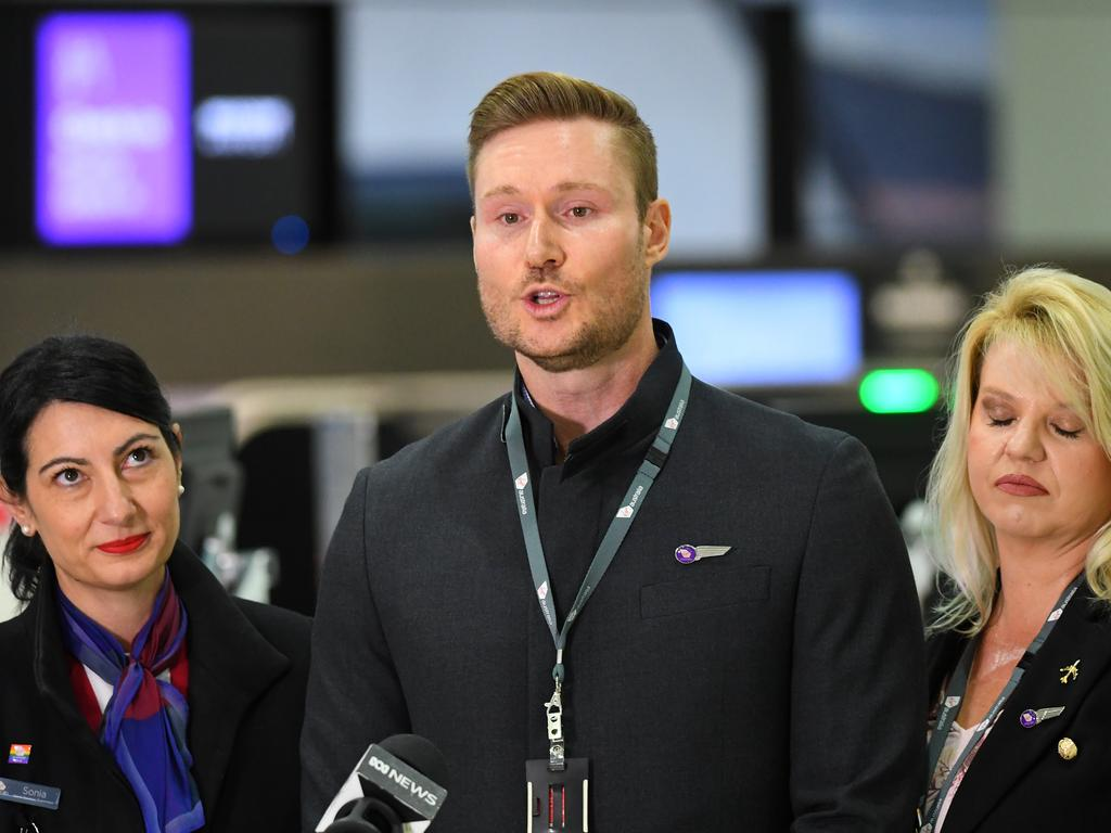 Virgin Australia employee Tony Smith (centre) speaks to the media at Melbourne Airport on Monday. Picture: AAP Image/James Ross