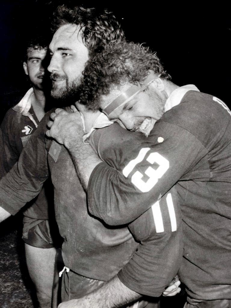 Queensland prop Greg Dowling (right) hugs Bryan Niebling in the 1987 State of Origin at Lang Park. (Picture: File)