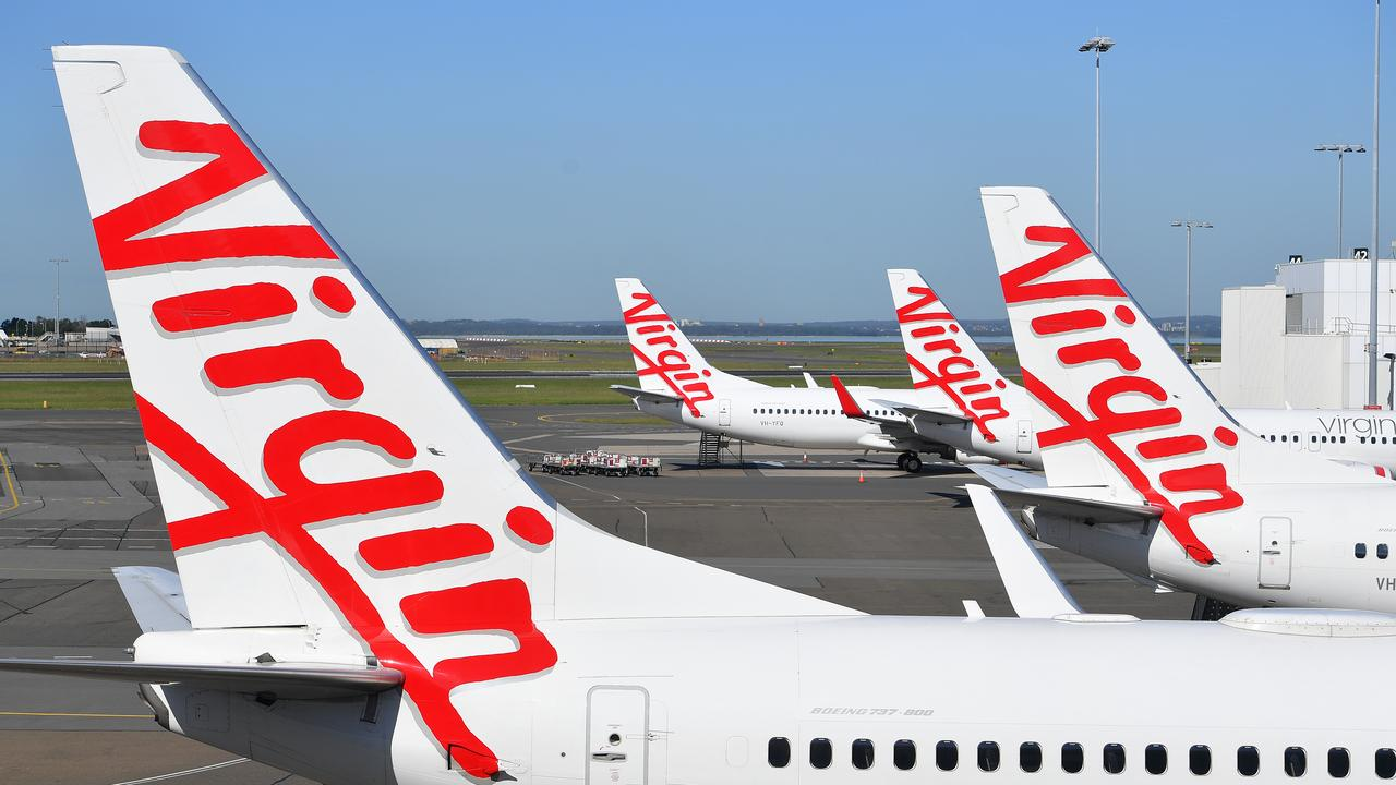 Virgin Australia confirmed it has gone into voluntary administration, handing the airline over to insolvency experts at Deloitte to restructure the business. Photo: Dan Himbrechts