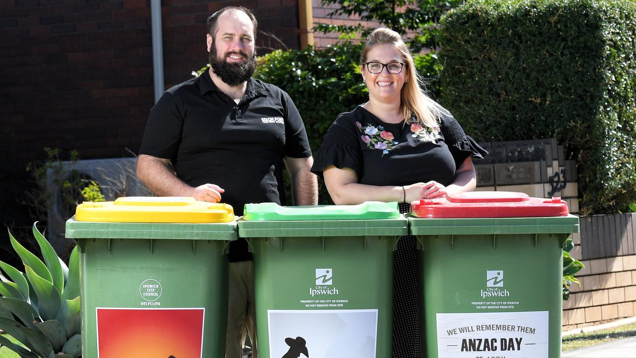 On Point Media Solutions creative director Dave Reid and managing director Kerryn Costello show the ANZAC bin stickers they have for sale.