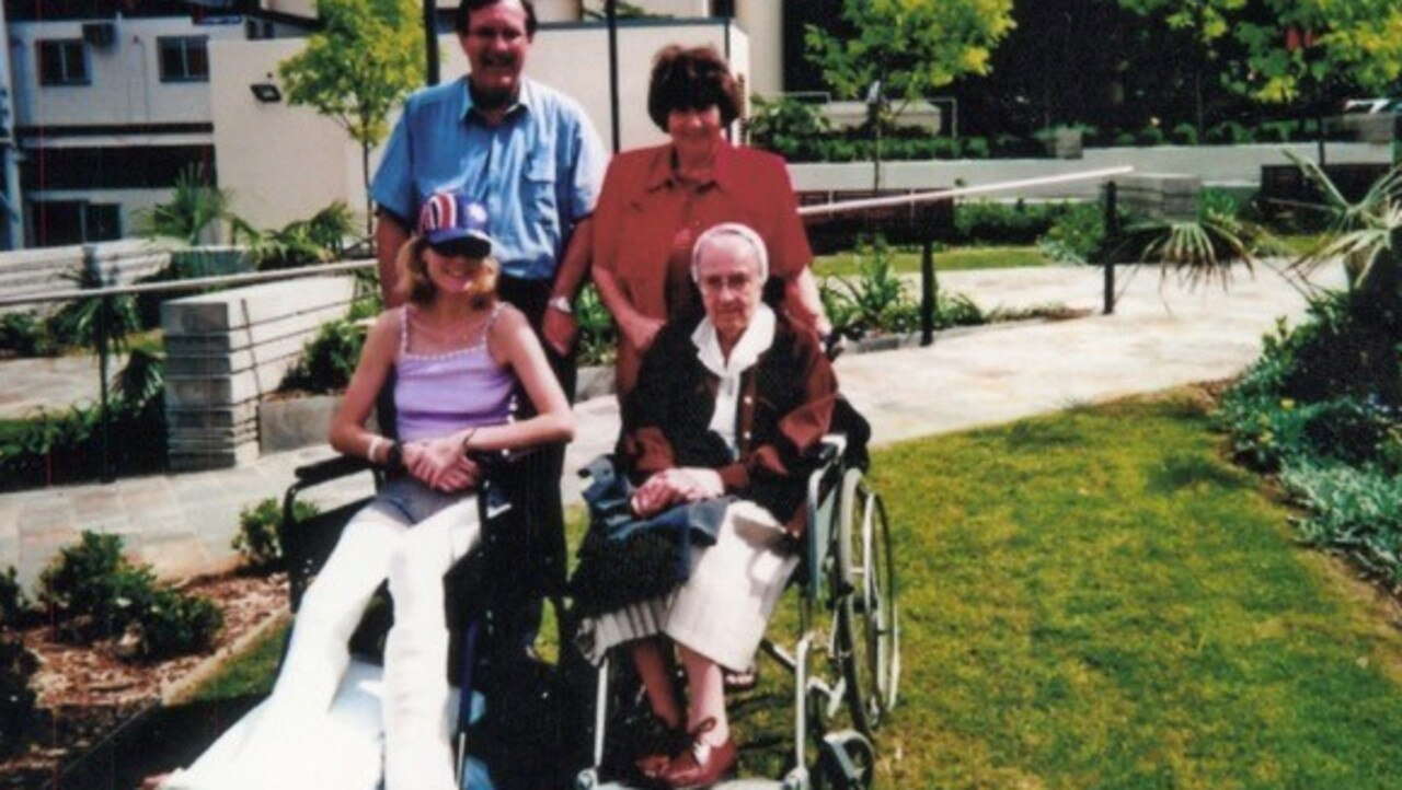 Clare in a wheelchair with her parents and great aunt Elsie. (September 2000)