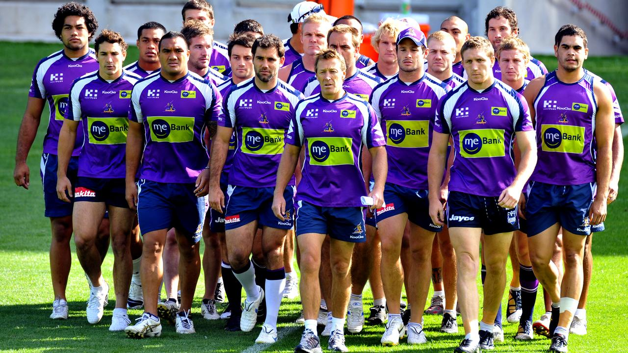Craig Bellamy leads the Storm in a march of unity to address the media regarding findings that the club had systematically cheated and lied.