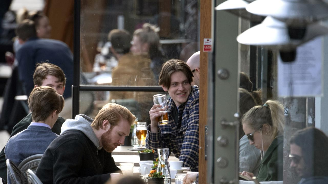 People enjoy themselves at an outdoor restaurant, amid the coronavirus outbreak, in central Stockholm, Sweden.