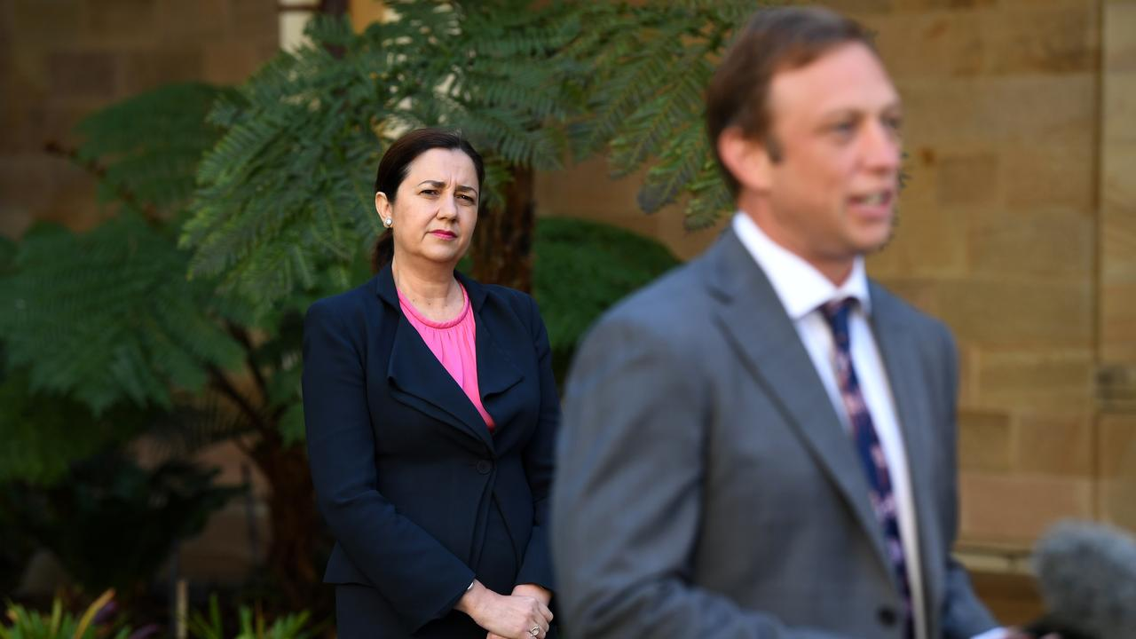 Queensland Premier Annastacia Palaszczuk watches Health Minister Steven Miles during a press conference at Parliament House in Brisbane, Wednesday, April 22, 2020. Queensland has recorded no new cases of coronavirus in the past 24 hours. (AAP Image/Dan Peled)
