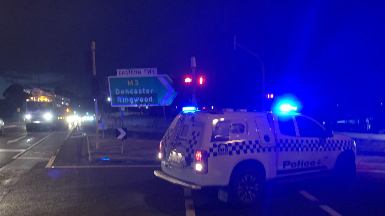 Police have blocked off the Eastern Fwy at Kew. Picture: Josh Fagan
