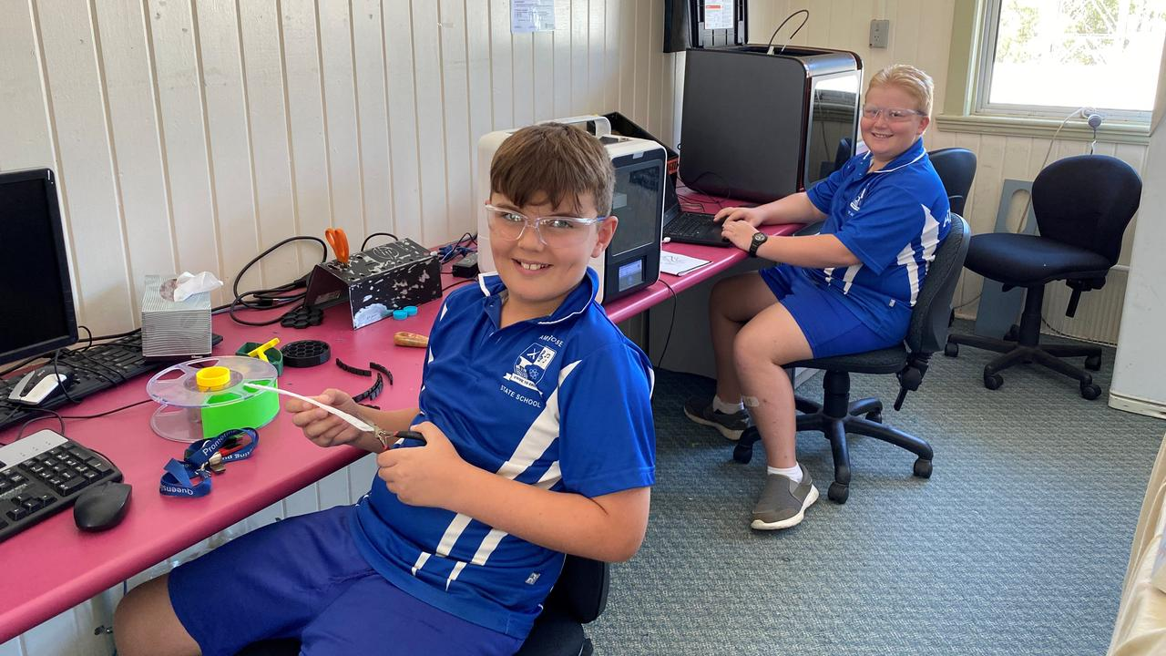 Phoenix Collis and Archer Peart of Year 5 at Ambrose State School making 3D printed Ear Saver clips for staff at Gladstone Hospital.