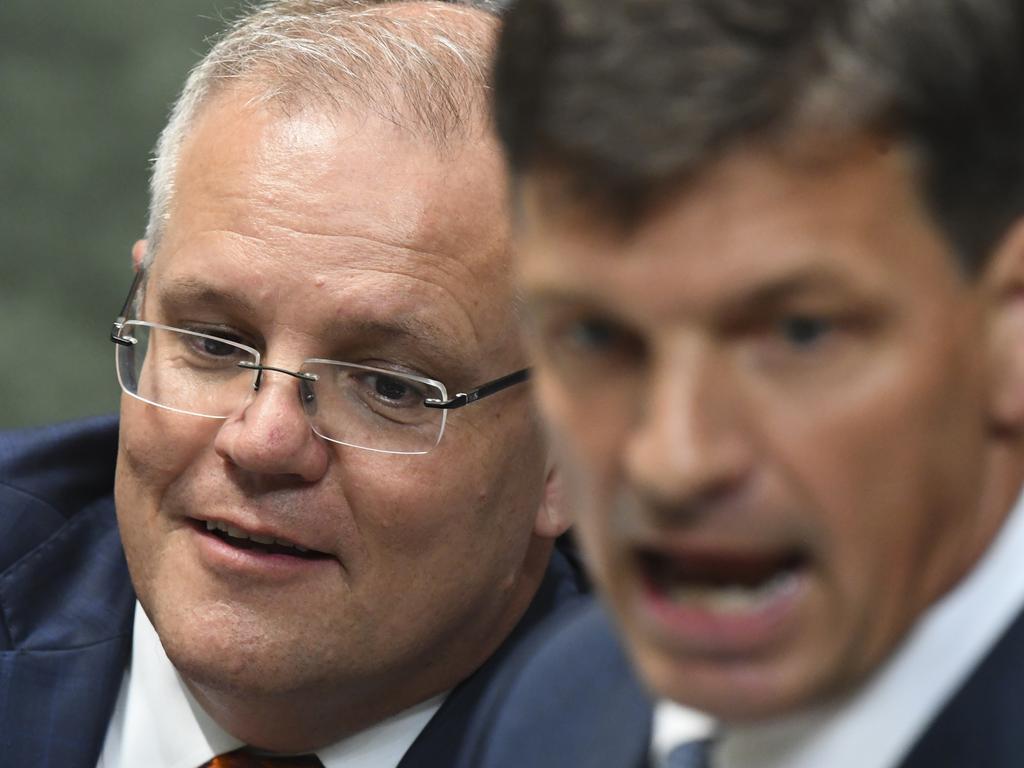 Australian Prime Minister Scott Morrison listens to Australian Energy Minister Angus Taylor. Picture: Lukas Coch/AAP