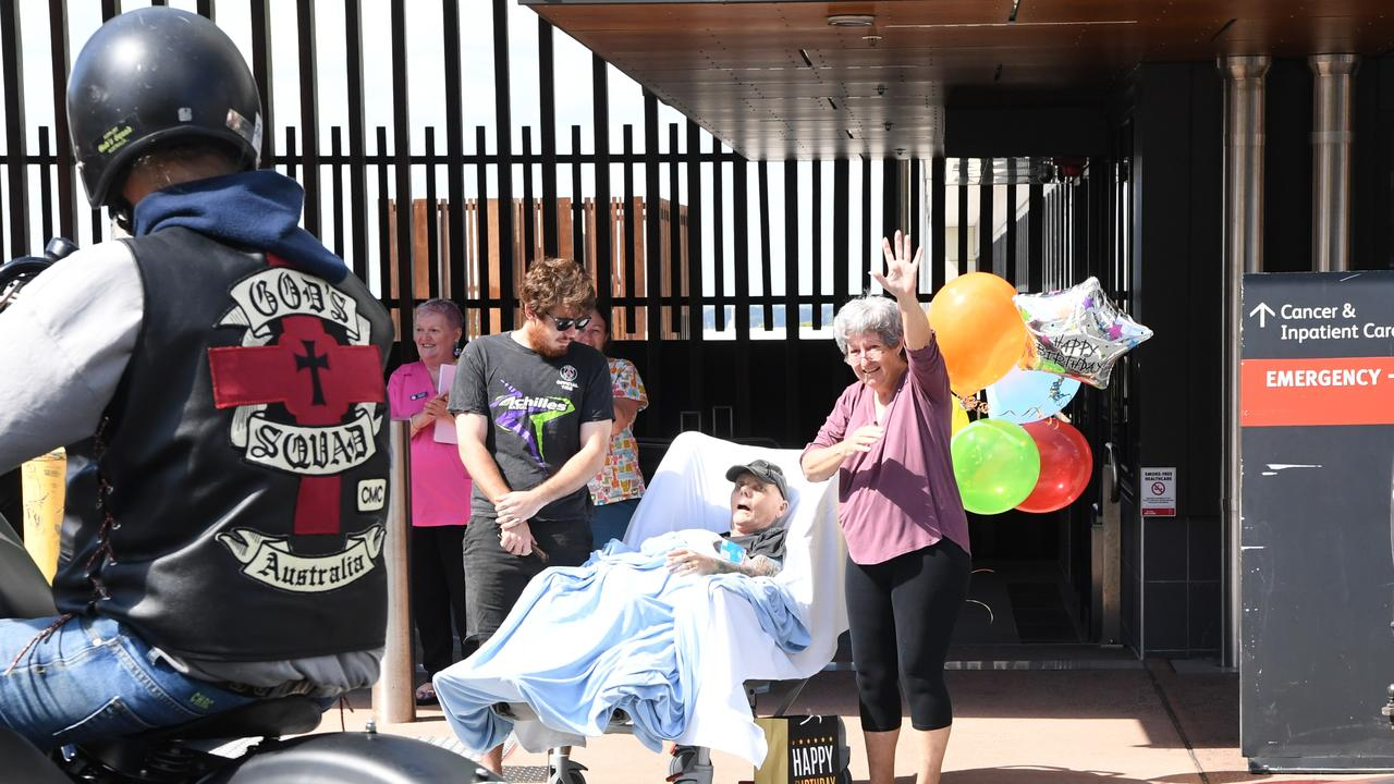 Noel Gill, son Jake and wife Gayle wave to birthday wellwishers outside the Rockhampton Hospital
